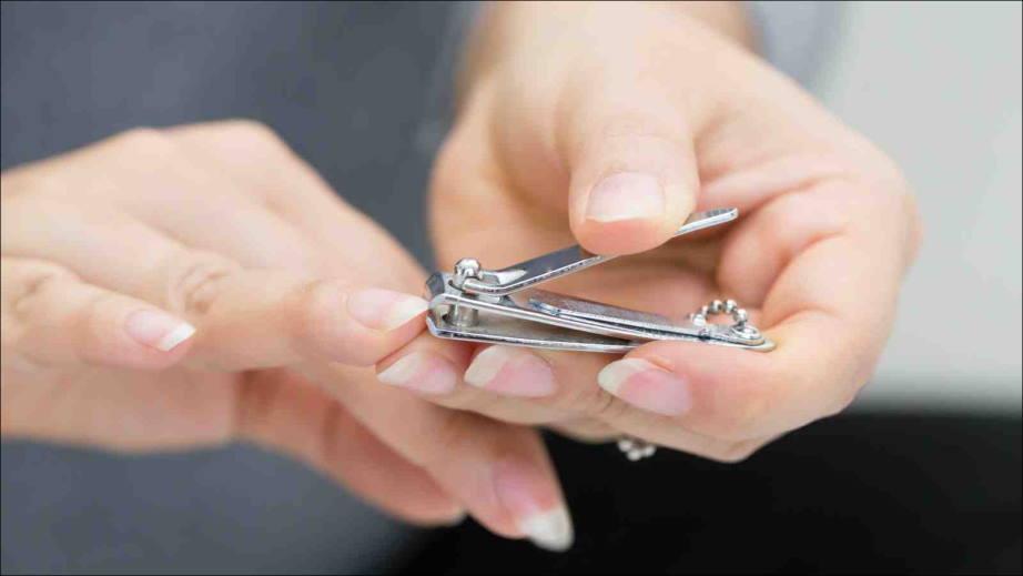 trim nails before a manicure